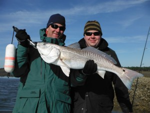 Jeff and his sporting buddy Mike with a true stud inshore Red, 13 plus pounds!